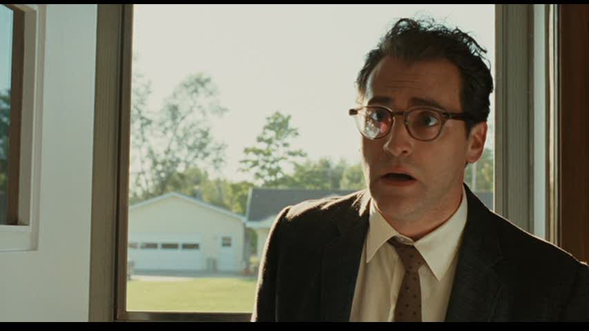"a serious man ""a serious man"" is the story of an ordinary man's search for clarity in a universe where jefferson airplane is on the radio and ""f–troop"" is on tv it is 1967, and larry gopnik (michael stuhlbarg), a physics professor at a quiet midwestern university, has just been informed by his wife judith (sari lennick) that she is leaving him."